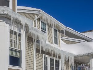 Ice Dam and Icicles on Roof of House